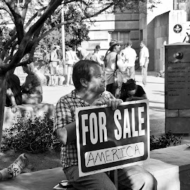 . by Krystle-lee Dodson - News & Events Politics ( for sale, sitting, america, black and white, protest,  )