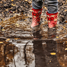 Paddling in puddles by Mark Thompson - Nature Up Close Water ( water, reflection, mud, wellies, leaves, boots )