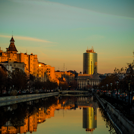River tower by Laura Belanu - City,  Street & Park  Street Scenes ( reflection, sunset, buildings, city, river )