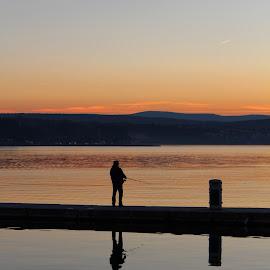 man fishing. by Katarina Brusić - Digital Art People ( adriatic, reflection, peaceful, sunset, sea, man )