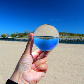 by Dipali S - Artistic Objects Other Objects ( hand, rfraction, sky, blue, beach )
