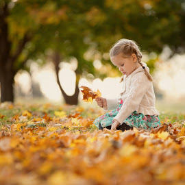 Autumn beauty by Kari Layland - Babies & Children Children Candids ( playing, child, fall leaves, little girl, autumn leaves, cute girl, braids, child portrait, autumn colors )