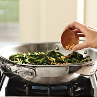 Sautéed Spinach, Currants and Pine Nuts