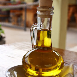 small bottle of salad oil by Biserka Vrđuka - Food & Drink Eating (  )