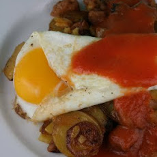 Yukon Gold and Chicken Apple Sausage Hash with Fried Eggs and Spicy Tomato Coulis