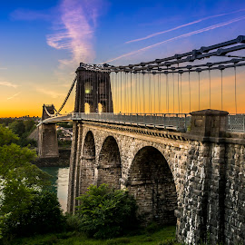 The Menai Bridge by Marek Saj - Buildings & Architecture Bridges & Suspended Structures ( skyline, old, wales, green, old city, old town, sky line, landscape, spring, sun, suspended, sky, blue, sunset, landscape photography, sunrise, bridge, landscapes, bridges, nikon, britain )