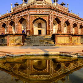 by PINAKI MITRA - Buildings & Architecture Public & Historical ( muslim, tomb, reflection, mausoleum, islamic, stone, sandstone, indian, architecture, delhi, symmetrical, red, new delhi, humayun tomb, pink, india, symmetry, humayun's tomb, medieval, humayun )