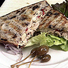 Tuna and Artichoke Salad on Kalamata Olive Bread with Provolone Cheese and Fresh Herb and Garlic Aioli