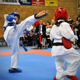 Attack by Marco Bertamé - Sports & Fitness Other Sports ( leg, red, blue, fight, white, kumite, children, attack, karate )