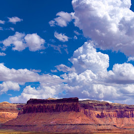 Following the light by Candee Watson - Landscapes Travel ( car, clouds, sky, blue, grass, canyon lands, arches, scenery, travel, rocks, roads,  )