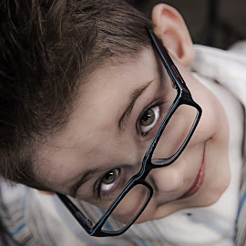 Above the Rims by Pat Bryan - Babies & Children Child Portraits ( child, glasses, young, boy, kid, eyes )