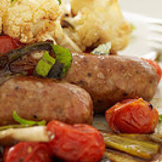 Roasted Sausages with Balsamic Burst Tomatoes and Parmigiano-Reggiano Cauliflower
