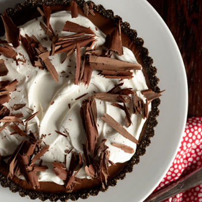 Triple Chocolate Tart with Boozy Whipped Cream