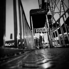 entrance to the by Julie Dabour - City,  Street & Park  Amusement Parks ( blackandwhite, ferriswheel, rides, floorperspective, festivals, creepy, entrance, allentown, pennsylvania, greatallentownfair )