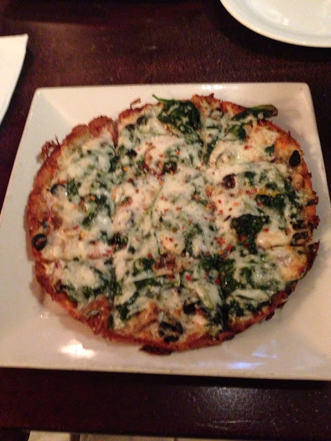 Gluten Free Veggie Pizza with garlic and spinach.