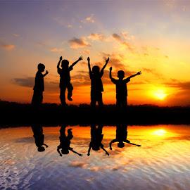 mlumpat by Indra Prihantoro - Babies & Children Children Candids ( sunset )