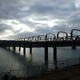 Sun rises over the Bridge by Pamela Howard - Buildings & Architecture Bridges & Suspended Structures ( water, clouds, reflection, structure, sky, murray bridge, river murray, bridge )