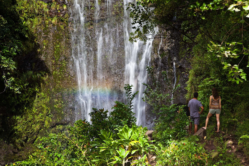 A couple takes in Wailua Falls in Hana on the east side of Maui.