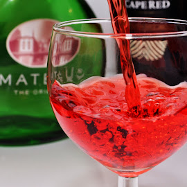 Glass of wine? by Allan Benson - Food & Drink Alcohol & Drinks ( wine, red, pouring, bottle, mateus )