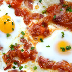 Eggs Baked on Grits with Bacon and Tomatoes