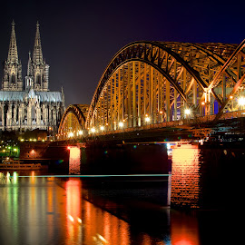 Cologne at Night by Aman Rawal - City,  Street & Park  Night ( cologne, hohenzollern bridge, night, long exposure, kölner dom, architecture, bridge, köln, cologne cathedral, hohenzollernbrücke, city )