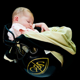 The daughter of a Football Player by Flemming Nielsen - Babies & Children Babies ( football, amercian football, sport, sleeping, baby, helmet )