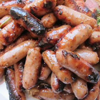 Sticky, Spicy, Sweet Maille Honey Balsamic Dijon Cocktail Sausages with Fresh Herbs