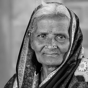 Gardner by Ravikanth Kurma - People Portraits of Women ( wrinkles, gardner, old, curious, hampi, saree, women )
