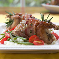 Bacon-Wrapped Quail Stuffed with Goat Cheese