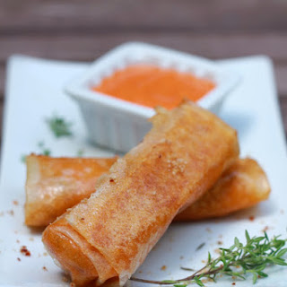 Crispy Spring Rolls With Mussels And Red Pepper Sauce.