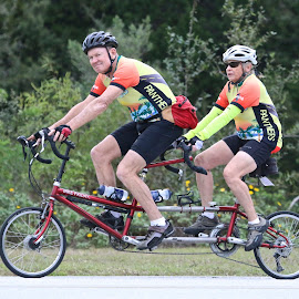 What's that you're pointing at us? by Sandy Scott - Transportation Bicycles ( cyclist, couple riding bicycle, bicycle built for two, bicycling, tandem bicycle, sports, travel, transportation )