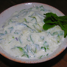 Cool, muddled cucumber raita with a happy hour option