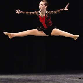 Ballerina In Red by Jerry Ehlers - People Musicians & Entertainers ( red, girl, jumping, split legs, high, ballerina, black,  )