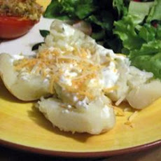 Tangy Cheese-Topped Spuds