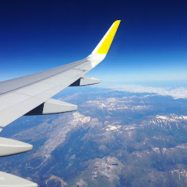 Airplane and view in flight by Louisa Livingstone - Transportation Airplanes ( passenger, flying, mountains, wing, sky, window, airplane, horizon, aerial, view, spain )