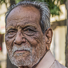 Wrinkled Face by Chittaranjan Bhat - People Portraits of Men