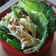 Make-Ahead Coconut-Poached Chicken with Spring Vegetables and Cashews