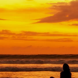 Bali sunset Silhouettes by Egor Tupikov - Landscapes Sunsets & Sunrises ( bali, waves, sea, ocean, yellow, beach, sky, red, vacation, girl, peoples, sunset, indonesia, silhouettes, cloud, summer, light, golden hour, sunrise, improving mood, moods, love, the mood factory, inspirational, passion, passionate, enthusiasm )