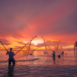 Go Cong sunrise by LietHung Tran - People Street & Candids ( clouds, skyline, fish, colors, waves, clouds and sea, sea, guardhouse, seascape, net, fishermen, sky, fishing, men )