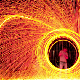 by Dotan Naveh - Abstract Fire & Fireworks ( bright, swirl, round, vibrant, circle, yellow, blaze, heat, photography, flame, fiery, danger, spinning, nature, trail, dark, spin, motion, wool, painting, light, abstract, orange, texture, backgrounds, art, beautiful, image, steel, burning, dangerous, fire, amazing, red, pattern, color, outdoors, background, hot, fireworks, night, glowing, burn, energy )
