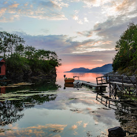 The silent jetty by Neil Gosling - Landscapes Sunsets & Sunrises ( water, mountain range, sunset, jetty, boat, evening, sun, norway,  )