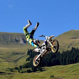 biker by Claude Huguenin - Sports & Fitness Other Sports ( crazy, biker, in the air, motorcycle, show )