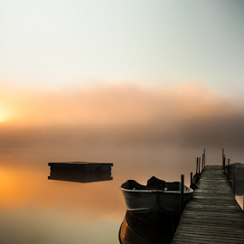 Calm, Misty Lake With Pier And Boats (Wide Shot Of Pier) by Joe Boyle - Landscapes Waterscapes ( fog, beautiful, lake, sunrise, mist )