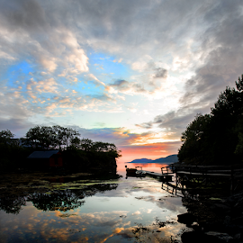 Norwegian sunset by Neil Gosling - Landscapes Cloud Formations ( water, reflection, row boat, rowing boat, silhouette, jetty, motor boat, boat, sun, norway, sunset, pier, cloud, fishing, evening )
