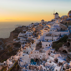 City of Oia by Joy Jiao - Landscapes Travel ( cliffs, sunset, greece, architecture, oia, windmill, santorini, island )