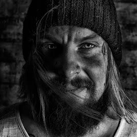 Selfie. by Niklas Skur - People Portraits of Men ( model, one person, guy, black and white, blond hair, long hair, dark colours, black white, blond, 30-35 years, adult, concrete, hat, blackandwhite, blonde, beard, bright eyes, moustache, mustache, man, dark colors )
