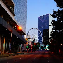 paradise ahead by Eric Taylor - City,  Street & Park  Vistas ( street, twilight, glass, steel, ferris wheel, city )