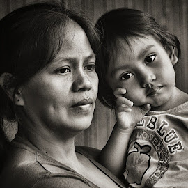 Mother and child by Jerome Mojica - People Family
