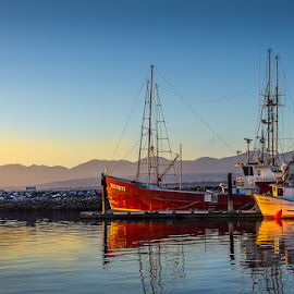 by Barb Postal - Transportation Boats ( reflection, mountains, fishing boats, sunset, ocean )