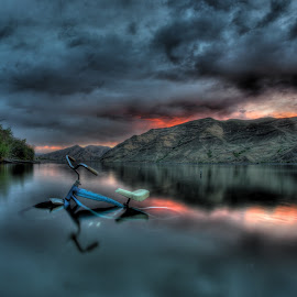Bike Above Water by Eric Demattos - Transportation Bicycles ( water, clouds, mountains, sunset, blue bike, storm )